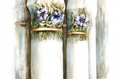 A Reök-palota hordóformájú zömök, virágdíszes oszlopai